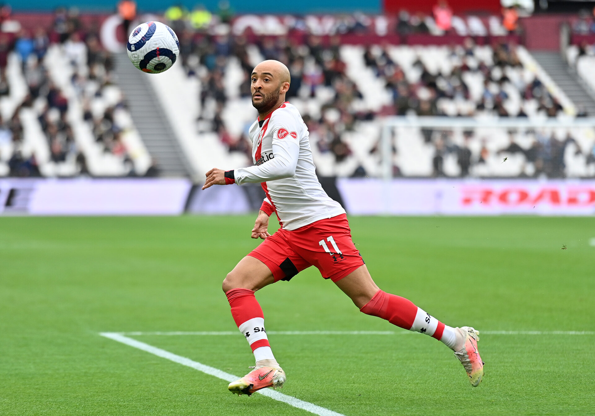 LONDON, ENGLAND - MAY 23: Nathan Redmond of Southampton runs with the ball  during the Premier League match between West Ham United and Southampton at London Stadium on May 23, 2021 in London, England. A limited number of fans will be allowed into Premier League stadiums as Coronavirus restrictions begin to ease in the UK. (Photo by Justin Tallis - Pool/Getty Images)