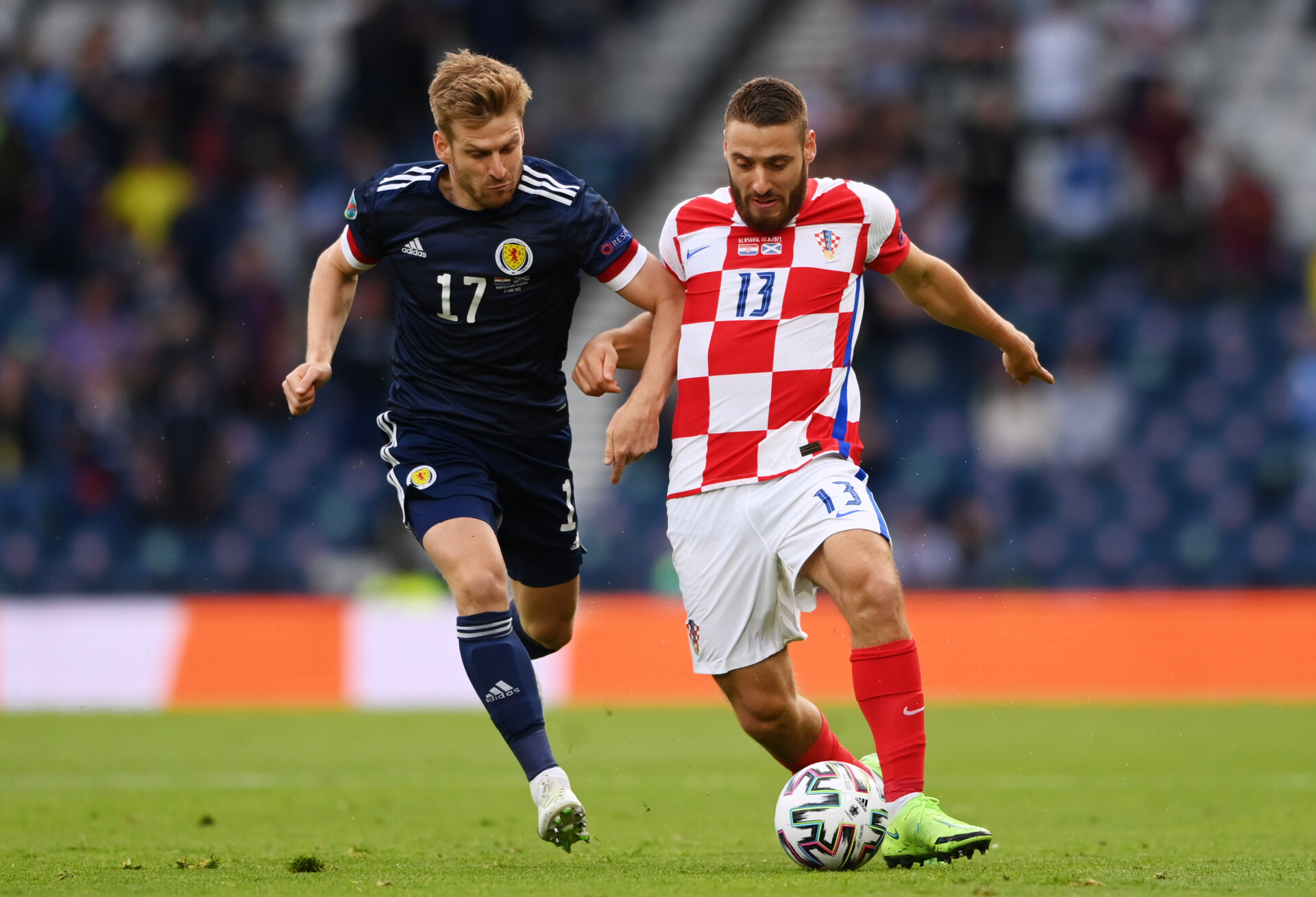 GLASGOW, SCOTLAND - JUNE 22: Nikola Vlasic of Croatia is closed down by Stuart Armstrong of Scotland during the UEFA Euro 2020 Championship Group D match between Croatia and Scotland at Hampden Park on June 22, 2021 in Glasgow, Scotland. (Photo by Stu Forster/Getty Images)