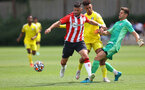 SOUTHAMPTON, ENGLAND - JULY 24: Shane Long of Southampton wins the ball ahead of the Fulham defence during a pre-season friendly match between Southampton FC and Fulham at The Staplewood Campus on July 24, 2021 in Southampton, England. Photo by Matt Watson/Southampton FC via Getty Images