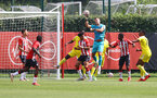 SOUTHAMPTON, ENGLAND - JULY 24: Fraser Forster of Southampton punches the ball clear during a pre-season friendly match between Southampton FC and Fulham at The Staplewood Campus on July 24, 2021 in Southampton, England. Photo by Matt Watson/Southampton FC via Getty Images