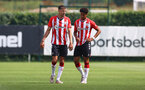 SOUTHAMPTON, ENGLAND - JULY 24: Jan Bednarek(L) and Oludare Olufunwa of Southampton during a pre-season friendly match between Southampton FC and Fulham at The Staplewood Campus on July 24, 2021 in Southampton, England. Photo by Matt Watson/Southampton FC via Getty Images