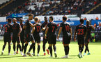 SWANSEA, WALES - JULY 31: Stuart Armstrong(17) of Southampton is congratulated by his team mates after scoring during the pre-season friendly match between Swansea City and Southampton FC, at The Liberty Stadium on July 31, 2021 in Swansea, Wales. (Photo by Matt Watson/Southampton FC via Getty Images)