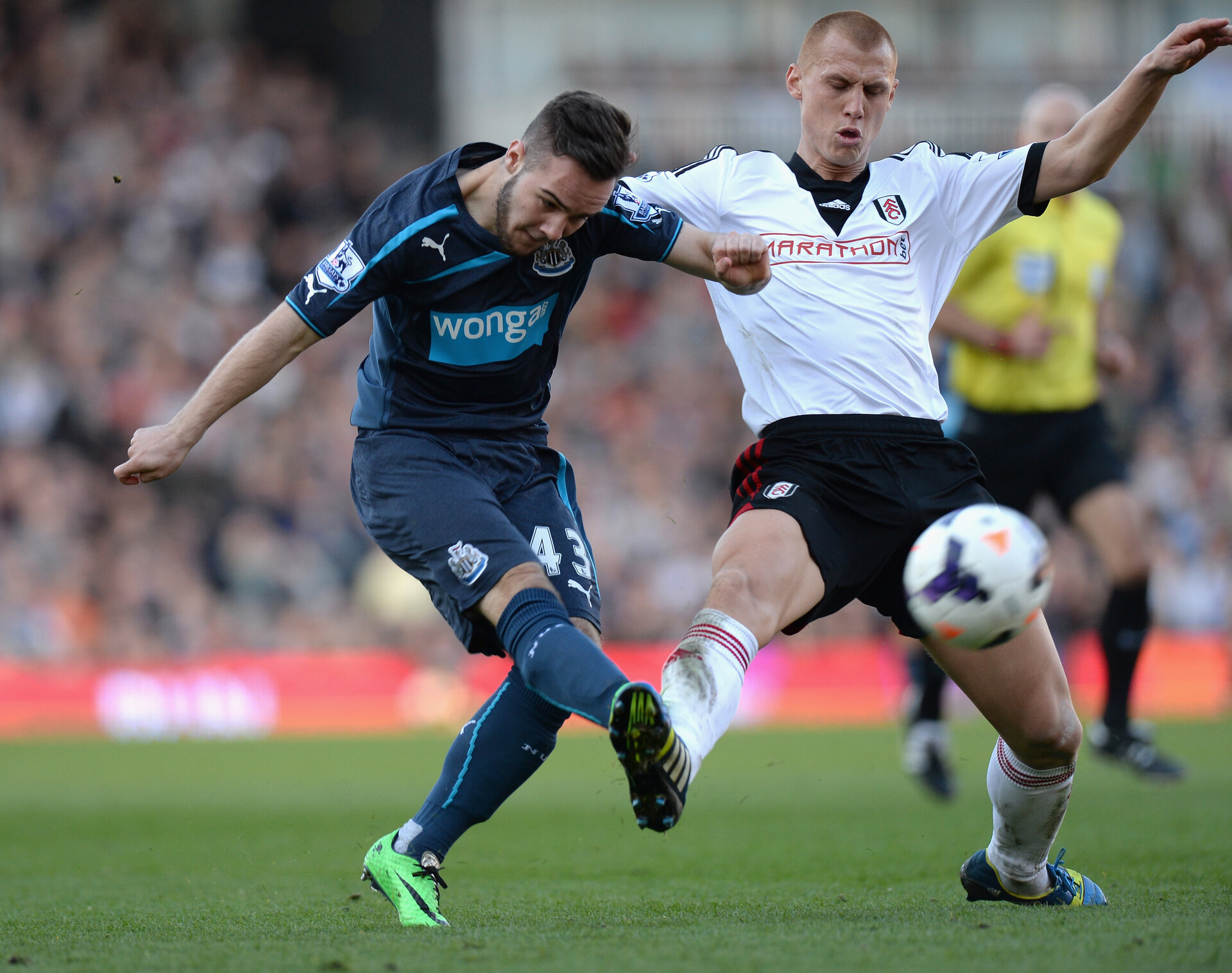 LONDON, ENGLAND - MARCH 15: Steve Sidwell of Fulham tackles Adam Armstrong of Newcastle United during the Barclays Premier League match between Fulham and Newcastle United at Craven Cottage on March 15, 2014 in London, England.  (Photo by Tony Marshall/Getty Images)