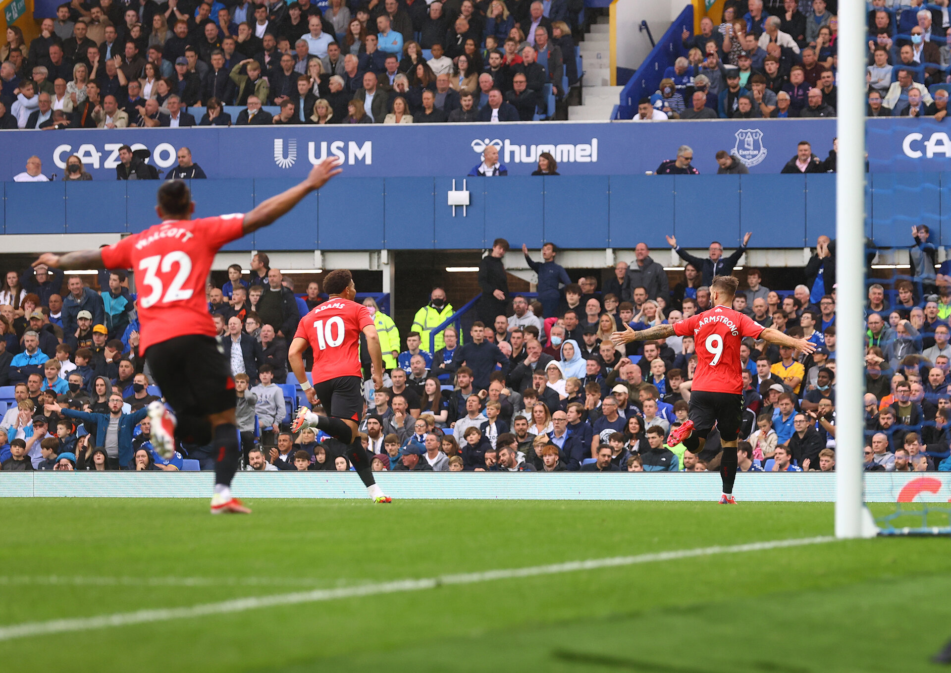 LIVERPOOL, ENGLAND - AUGUST 14: Adam Armstrong of Southampton celebrates after opening the scoring during the Premier League match between Everton  and  Southampton at Goodison Park on August 14, 2021 in Liverpool, England. (Photo by Matt Watson/Southampton FC via Getty Images)