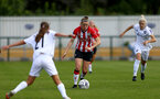 SOUTHAMPTON, ENGLAND - AUGUST 15: Ella Pusey(center) of Southampton during the FA Women's National League Southern Premier match between Southampton Women's and MK Dons Ladies at Snow's Stadium on August 15, 2021 in Southampton, England. (Photo by Isabelle Field/Southampton FC via Getty Images)
