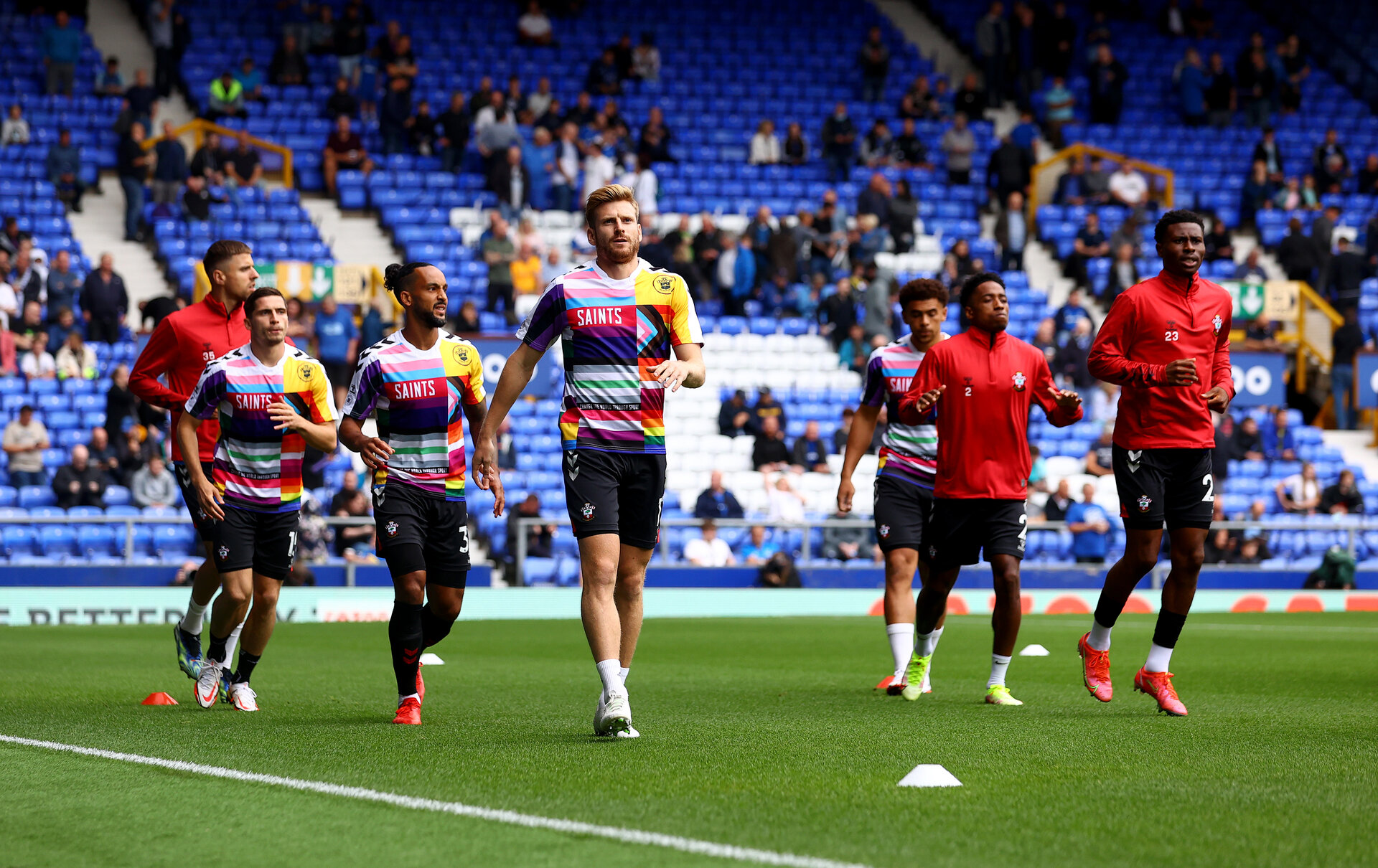LIVERPOOL, ENGLAND - AUGUST 14: Southampton players warm up during the Premier League match between Everton  and  Southampton at Goodison Park on August 14, 2021 in Liverpool, England. (Photo by Matt Watson/Southampton FC via Getty Images)