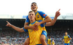 NEWCASTLE UPON TYNE, ENGLAND - AUGUST 28: James Ward-Prowse(front) of Southampton celebrates with Mohamed Elyounoussi on his back after scoring to make it 2-2 during the Premier League match between Newcastle United  and  Southampton at St. James Park on August 28, 2021 in Newcastle upon Tyne, England. (Photo by Matt Watson/Southampton FC via Getty Images)