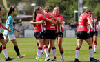 SOUTHAMPTON, ENGLAND - AUGUST 29: Southampton players congratulate Ella Morris(center) of Southampton on scoring during Women's National League Southern Premier match between Southampton Women and Gillingham at Snows Stadium on August 29, 2021 in Southampton, England. (Photo by Isabelle Field/Southampton FC via Getty Images)
