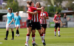 SOUTHAMPTON, ENGLAND - AUGUST 29: Southampton players congratulate Ella Morris(L) of Southampton on scoring during Women's National League Southern Premier match between Southampton Women and Gillingham at Snows Stadium on August 29, 2021 in Southampton, England. (Photo by Isabelle Field/Southampton FC via Getty Images)