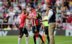 SOUTHAMPTON, ENGLAND - SEPTEMBER 11: Adam Armstrong(L) of Southampton comes off for Armando Broja(18) of Southampton during the Premier League match between Southampton  and  West Ham United at St Mary's Stadium on September 11, 2021 in Southampton, England. (Photo by Isabelle Field/Southampton FC via Getty Images)
