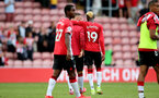 SOUTHAMPTON, ENGLAND - SEPTEMBER 11: Adam Armstrong(center) and Moussa Djenepo(R) of Southampton during the Premier League match between Southampton  and  West Ham United at St Mary's Stadium on September 11, 2021 in Southampton, England. (Photo by Isabelle Field/Southampton FC via Getty Images)
