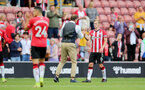 SOUTHAMPTON, ENGLAND - SEPTEMBER 11: Ralph Hasenhuttl Southampton manager and James Ward-Prowse(R) of Southampton during the Premier League match between Southampton  and  West Ham United at St Mary's Stadium on September 11, 2021 in Southampton, England. (Photo by Isabelle Field/Southampton FC via Getty Images)