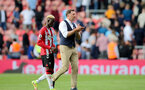 SOUTHAMPTON, ENGLAND - SEPTEMBER 11: Moussa Djenepo(L) of Southampton and Ralph Hasenhuttl Southampton manager during the Premier League match between Southampton  and  West Ham United at St Mary's Stadium on September 11, 2021 in Southampton, England. (Photo by Isabelle Field/Southampton FC via Getty Images)