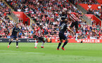 SOUTHAMPTON, ENGLAND - SEPTEMBER 11: Armando Broja(R) of Southampton wins a header during the Premier League match between Southampton  and  West Ham United at St Mary's Stadium on September 11, 2021 in Southampton, England. (Photo by Matt Watson/Southampton FC via Getty Images)