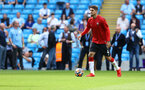 MANCHESTER, ENGLAND - SEPTEMBER 18: Lyanco of Southampton warms up ahead of the Premier League match between Manchester City and Southampton at Etihad Stadium on September 18, 2021 in Manchester, England. (Photo by Matt Watson/Southampton FC via Getty Images)