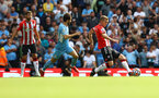 MANCHESTER, ENGLAND - SEPTEMBER 18: James Ward-Prowse(R) of Southampton during the Premier League match between Manchester City and Southampton at Etihad Stadium on September 18, 2021 in Manchester, England. (Photo by Matt Watson/Southampton FC via Getty Images)