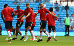 MANCHESTER, ENGLAND - SEPTEMBER 18: James Ward-Prowse(R) of Southampton leads the warm up during the Premier League match between Manchester City and Southampton at Etihad Stadium on September 18, 2021 in Manchester, England. (Photo by Matt Watson/Southampton FC via Getty Images)