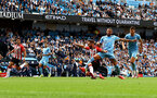 MANCHESTER, ENGLAND - SEPTEMBER 18: Adam Armstrong(L) of Southampton and Kyle Walker(R) of Manchester City during the Premier League match between Manchester City and Southampton at Etihad Stadium on September 18, 2021 in Manchester, England. (Photo by Matt Watson/Southampton FC via Getty Images)