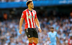 MANCHESTER, ENGLAND - SEPTEMBER 18: Che Adams of Southampton during the Premier League match between Manchester City and Southampton at Etihad Stadium on September 18, 2021 in Manchester, England. (Photo by Matt Watson/Southampton FC via Getty Images)
