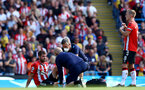 MANCHESTER, ENGLAND - SEPTEMBER 18: Jack Stephens of Southampton receives treatment during the Premier League match between Manchester City and Southampton at Etihad Stadium on September 18, 2021 in Manchester, England. (Photo by Matt Watson/Southampton FC via Getty Images)