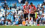 MANCHESTER, ENGLAND - SEPTEMBER 18: James Ward-Prowse(L) and Mohamed Elyounoussi of Southampton during the Premier League match between Manchester City and Southampton at Etihad Stadium on September 18, 2021 in Manchester, England. (Photo by Matt Watson/Southampton FC via Getty Images)
