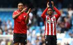MANCHESTER, ENGLAND - SEPTEMBER 18: Yan Valery(L) and Kyle Walker-Peters during the Premier League match between Manchester City and Southampton at Etihad Stadium on September 18, 2021 in Manchester, England. (Photo by Matt Watson/Southampton FC via Getty Images)