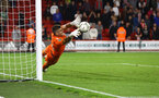 SHEFFIELD, ENGLAND - SEPTEMBER 21: Fraser Forster of Southampton stretches for a penalty during the Carabao Cup Third Round match between Sheffield United and Southampton at Bramall Lane on September 21, 2021 in Sheffield, England. (Photo by Matt Watson/Southampton FC via Getty Images)