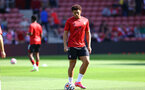 SOUTHAMPTON, ENGLAND - SEPTEMBER 26: Che Adams of Southampton warms up ahead of the Premier League match between Southampton and Wolverhampton Wanderers at St Mary's Stadium on September 26, 2021 in Southampton, England. (Photo by Matt Watson/Southampton FC via Getty Images)