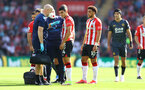 SOUTHAMPTON, ENGLAND - SEPTEMBER 26: Mohamed Elyounoussi of Southampton receives treatment from medical staff during the Premier League match between Southampton and Wolverhampton Wanderers at St Mary's Stadium on September 26, 2021 in Southampton, England. (Photo by Matt Watson/Southampton FC via Getty Images)