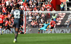 SOUTHAMPTON, ENGLAND - SEPTEMBER 26: Alex McCarthy of Southampton is beaten by Raul Jimenz of Wolverhampton Wanderers during the Premier League match between Southampton and Wolverhampton Wanderers at St Mary's Stadium on September 26, 2021 in Southampton, England. (Photo by Matt Watson/Southampton FC via Getty Images)