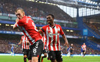 LONDON, ENGLAND - OCTOBER 02: James Ward-Prowse(L) of Southampton celebrates with his team mate Nathan Tella during the Premier League match between Chelsea and Southampton at Stamford Bridge on October 02, 2021 in London, England. (Photo by Matt Watson/Southampton FC via Getty Images)