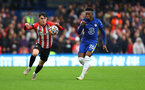LONDON, ENGLAND - OCTOBER 02: Tino Livramento(L) of Southampton during the Premier League match between Chelsea and Southampton at Stamford Bridge on October 02, 2021 in London, England. (Photo by Matt Watson/Southampton FC via Getty Images)
