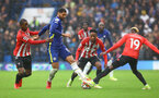 LONDON, ENGLAND - OCTOBER 02: Ibrahima Diallo(L), Kyle Walker-Peters and Moussa Djenepo(R) of Southampton tackle Ruben Loftus-Cheek of Chelsea during the Premier League match between Chelsea and Southampton at Stamford Bridge on October 02, 2021 in London, England. (Photo by Matt Watson/Southampton FC via Getty Images)
