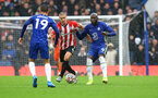 LONDON, ENGLAND - OCTOBER 02: Oriol Romeu(L) of Southampton and Romelu Lukaku(R) of Chelsea during the Premier League match between Chelsea and Southampton at Stamford Bridge on October 02, 2021 in London, England. (Photo by Matt Watson/Southampton FC via Getty Images)